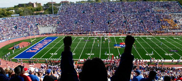 A Kansas fan gets pumped up after a stop by the Jayhawks during the second quarter Saturday, Sept. 26, 2009 at Kivisto Field.