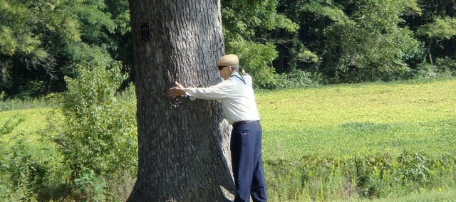 While documenting an 80th birthday weekend with my father, I was fortunate enough to capture this photograph of him hugging a tree. Having intended to self-publish a photography book from the trip, I was carrying a camera with me and alert to photo opportunities through the trip.