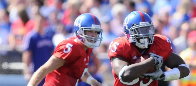 Kansas running back Toben Opurum takes a handoff from quarterback Todd Reesing during the second quarter, Saturday, Sept. 26, 2009 at Kivisto Field.