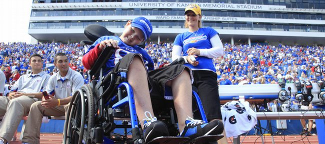 Jackson, 9, and his mother, Denise DeBrine, both of Olathe, attended Saturday's Kansas University football game in Memorial Stadium with ground-level seating, courtesy of KU. Jackson has a diagnosis of medulloblastoma, a form of brain cancer. For coverage of the game, see page 1C.