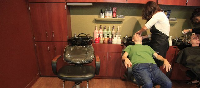 Lori Winfrey gets her hair shampooed at Hair Experts, 2100 W. 25th St. 