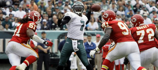 Philadelphia quarterback Michael Vick (7) passes under pressure from Kansas City Chiefs linebacker Corey Mays (51), defensive end Tamba Hali (91) and defensive tackle Glenn Dorsey in the first quarter. Vick and the Eagles routed the Chiefs, 34-14, Sunday in Philadelphia.