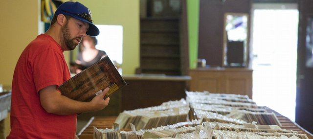 Josh Mahoney, Lawrence, thumbs through the record bins at The Love Garden, 822 Mass. The store is moving from its longtime second-story home at 936 1/2 Mass. to new street-level digs.