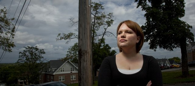 Kansas University senior Elise Higgins, Topeka, is working with city officials and neighborhood and student groups to address the issue of poor lighting conditions between campus and downtown, specifically in the Oread neighborhood, to help make the area more safe. She is pictured Sept. 22 at the corner of 13th and Louisiana streets