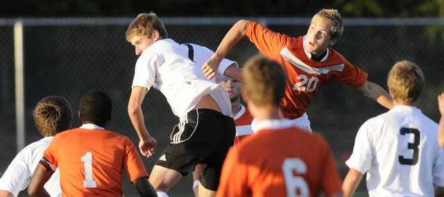 Free State's Tony Libeer, center, gets in position for a header against a Shawnee Mission Northwest player. The Firebirds won, 1-0, Tuesday night at Free State High.