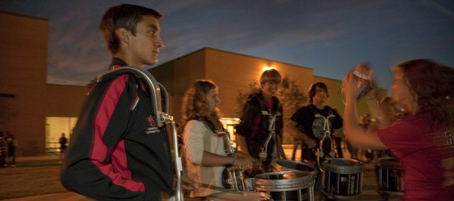 Lawrence High senior Jonathan Gabler, left, and other members of the school's Drum Line were part of the homecoming pep rally Wednesday at the school, 1901 La. LHS and Free State High School will play homecoming football games Friday at newly constructed athletic fields on their campuses.