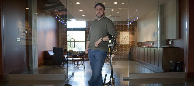 Rabbi Neal Schuster is the new senior Jewish educator to KU Hillel. He keeps an electric scooter at the Hobbs-Taylor Lofts location to commute back and forth to the KU campus.