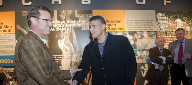 Kansas University basketball coach Bill Self, left, greets Kansas State coach Frank Martin at the Coaches Vs. Cancer Season Tipoff reception in 2009 at the College Basketball Experience, next to the Sprint Center in Kansas City, Mo.