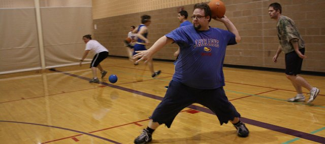 Joel Pfannenstiel fires a dodgeball during a Bleeding Kansas Dodgeball League game at the East Lawrence Recreation Center, 1245 E. 15th St.