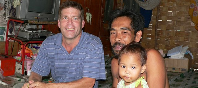 Tom Van Holt sits with victims of the Dec. 26, 2004 tsunami in Thailand.