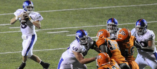 The Kansas offensive line buys quarterback Todd Reesing time against UTEP on Sept. 12 in El Paso, Texas. The offensive line earned praise from coach Mark Mangino this week.