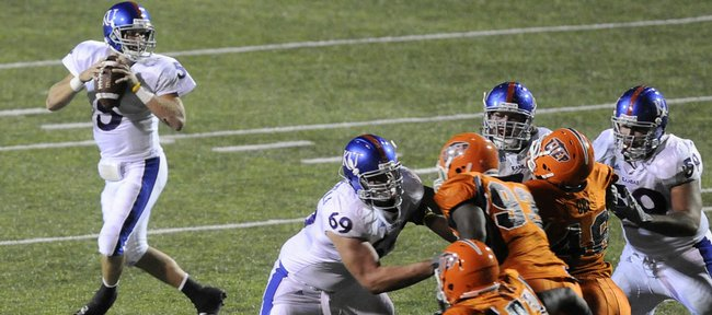 The Kansas offensive line buys quarterback Todd Reesing time against UTEP on Sept. 12 in El Paso, Texas. The offensive line earned praise from coach Mark Mangino this wee