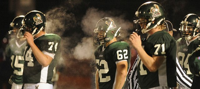 Members of the Free State High defense prepare for the final seconds of the fourth quarter against Olathe North. The Firebirds lost to the Eagles on Friday at Free State.