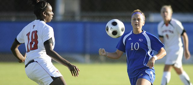 KU 's #10  Monica Dolinsky eyes a loose ball against Texas Techs' # 18 Morgan Johnson, as KU hosted Texas Tech Friday