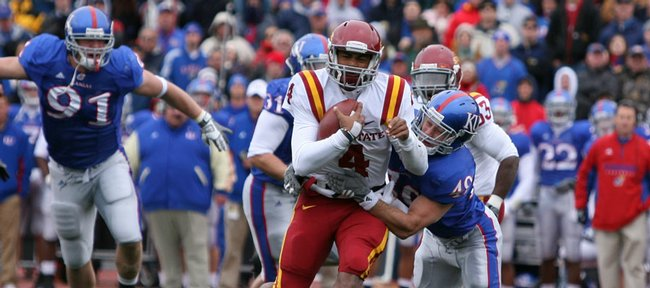 Kansas linebacker Drew Dudley wrestles down Iowa State quarterback Austen Arnaud during the second quarter, Saturday, Oct. 10, 2009 at Kivisto Field.