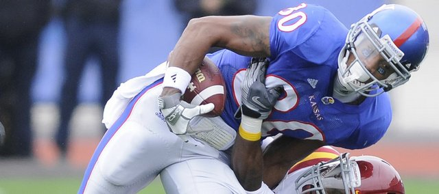 Kansas receiver Dezmon Briscoe is dragged down by Iowa State defensive back David Sims after a catch during the first quarter, Saturday, Oct. 10, 2009 at Kivisto Field.