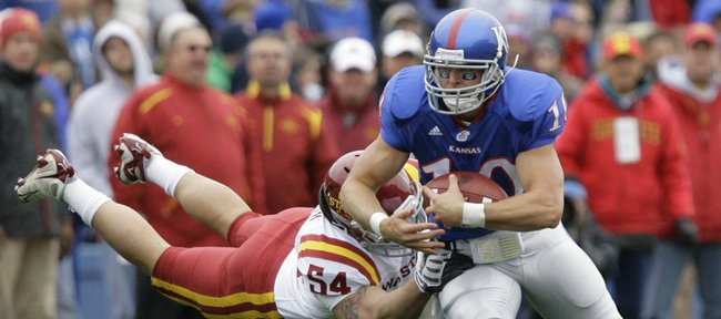 Kansas receiver Kerry Meier tries to get away from a tackle by Jesse Smith in the first half of the Kansas and Iowa State game Saturday.