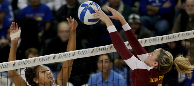 Iowa State's Kaylee Manns, right, contests a shot at the net by Kansas' Karina Garlington. The Jayhawks dropped a three-set loss to ISU Saturday at Horejsi Center.