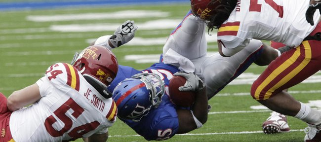 KU running back Toben Opurum gets wrapped up in the first half of the Kansas/Iowa State game.