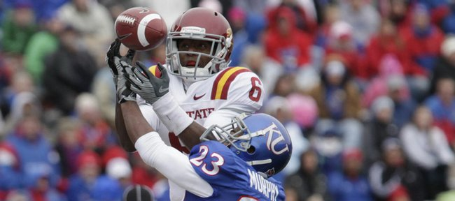 KU defensive back Ryan Murphy breaks up a pass against Darius Darks in the first half of KU's homecoming game against Iowa State.