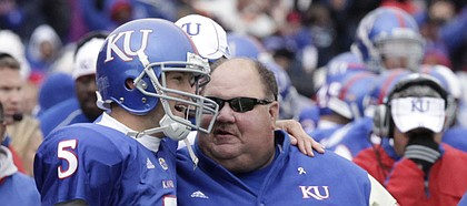 Kansas Quarterback Todd Reesing (5) chats with coach Mark Mangino after scoring against Iowa State. Mangino praised his quarterback Monday, saying Reesing deserves to be in the conversation for the Heisman Trophy.