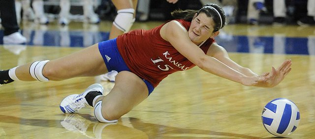 KU's  Allison Mayfield (15) tries to dig up a serve against Texas Wednesday night. KU lost to the No. 2 Longhorns.
