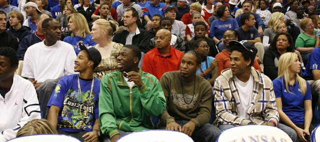 Kansas University basketball recruits, from left, Dominic Cheek, Elijah Johnson, Michael Snaer and Xavier Henry take in the action at the 2008 Late Night in the Phog in Allen Fieldhouse.