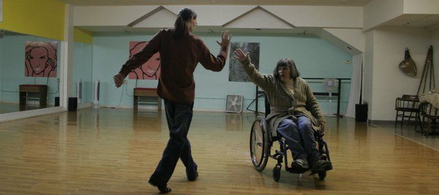 Instructor Chris Pruitt gives ballroom dancing lessons to Lawrence resident Lorraine Cannistra, a member of Groovability, a small Kansas City wheelchair ballroom dance troupe, which will stage a dance-a-thon fundraiser next weekend.