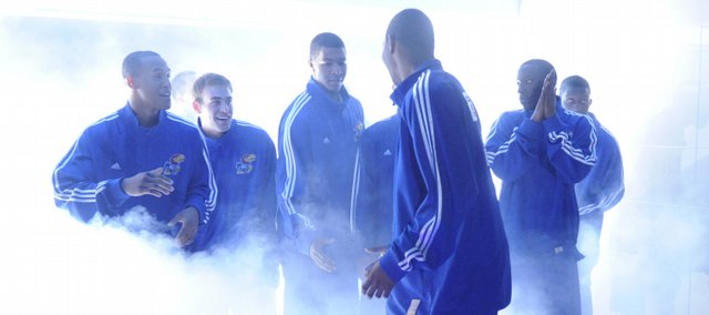 KU's Marcus Morris (front) jokes with teammates before entering the court during player introductions.