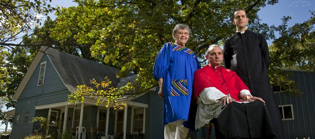 "Pope Michael, also known as David Bawden, is pictured outside his farmhouse in Delia with his mother, Clara ""Tickie"" Bawden, and Phil Friedl, a seminarian living and studying with him. In 1990, six family members and followers elected Bawden pope of the Catholic faith after recognizing personal differences with Church doctrine."