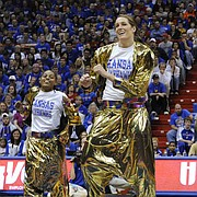 Krysten Boogaard, second from left, and Aishah Sutherland, right, lead a dance performance by the KU women's basketball team during Late Night.