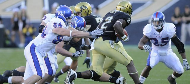 Kansas defensive end Jeff Wheeler can't get a handle on Colorado running back Darrell Scott during the first quarter Saturday, Oct. 17, 2009 at Folsom Field.