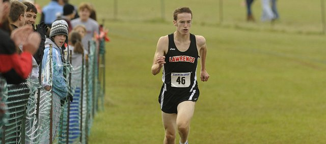 Lawrence High's Roy Wedge runs to victory at the Sunflower League cross country meet. Wedge's Lions also won the team title Saturday at Rim Rock Farm.