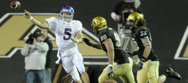 Kansas quarterback Todd Reesing gets rid of the football as Colorado defenders Marquez Herrod (90) and B.J. Beatty close in during the third quarter Saturday, Oct. 17, 2009 at Folsom Field.