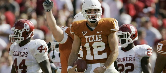 Texas quarterback Colt McCoy (12) celebrates on the final play of the game against Oklahoma. The Longhorns held off the Sooners, 16-13, on Saturday in Dallas.