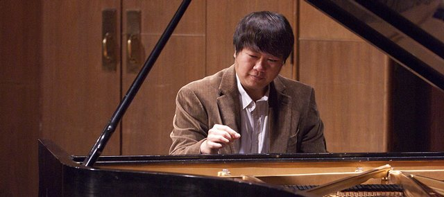"Kansas University's School of Music is organizing an ""Iron Chef""-style competition for composition students such as Jeremiah Li, pictured above. A performance from the event will be at 7:30 p.m. Friday."