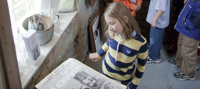 Rose Naramore-Winfrey explores exhibits at the Murphy-Bromelsick House. Third-graders from New York School toured the historic house at 10th and Delaware streets during a field trip Wednesday. Organizers are hoping to accommodate more student field trips at the site.