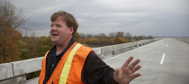 Rex Fleming, project engineer for the Kansas Turnpike, stands on a new Kansas River bridge that is expected to welcome traffic today. He said traffic heading west would move onto the bridge when there's a break in the weather.