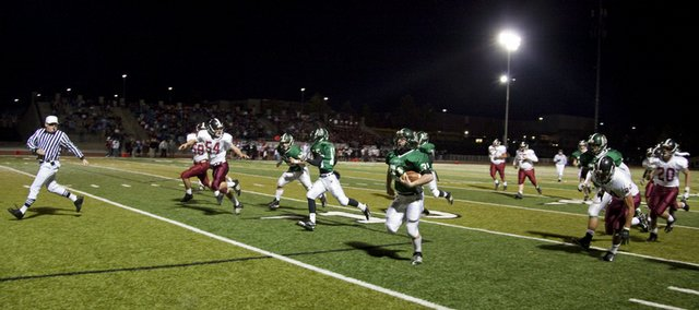 Free State linebacker Matt Cole returns a recovered fumble for a touchdown on the second play from scrimmage against Lawrence High during the first quarter on Friday at Free State High School.