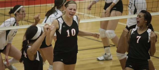 Lawrence High's Lillian Schonewise (10) and Kelsey Broadwell (7) celebrate a point against Free State. The Lions swept the Firebirds Thursday at LHS.