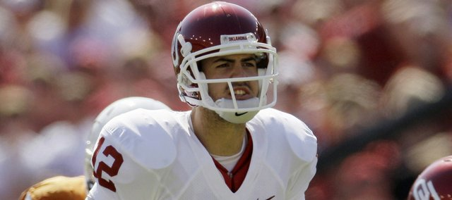 Oklahoma quarterback Landry Jones (12) makes a call at the line of scrimmage against Texas on Oct. 17 in Dallas. Jones will start against Kansas on Saturday.