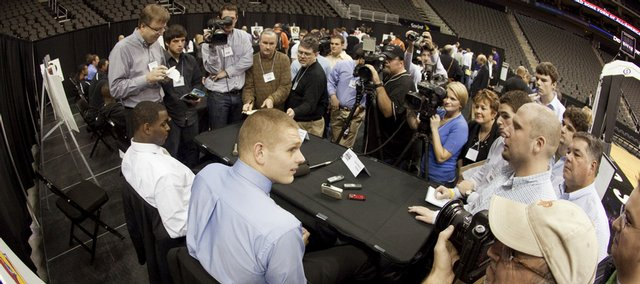 Kansas University center Cole Aldrich, seated at right, talks with a large group of media members about what he believes is a higher level of competition in the Big 12 Conference this year. At left is Sherron Collins, who also participated in Thursday's Big 12 Media Day in Kansas City, Mo.