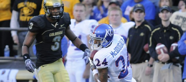 Kansas receiver Bradley McDougald (24) hauls in a pass in front of Colorado's Jimmy Smith. McDougald is the latest in a string of two-way players for the Jayhawks, doubling as a defensive back.