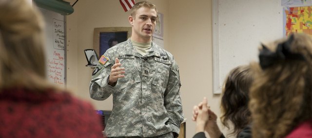 Capt. Sean Patton, a 2001 Lawrence High School and West Point graduate, talks about his experiences at the military academy and his service in Iraq during a visit Thursday to LHS.