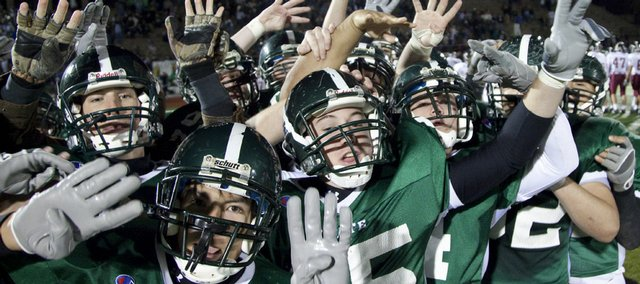 Members of the Free State football team signal No. 4 after their fourth consecutive victory over crosstown rival Lawrence High. The Firebirds won,  42-14, Friday at Free State High.
