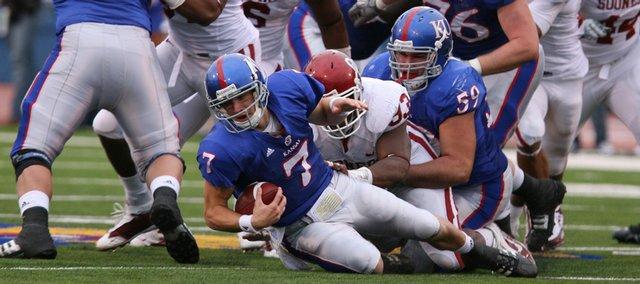Oklahoma defensive tackle Gerald McCoy brings down Kansas backup quarterback Kale Pick in the third quarter at Kivisto Field.