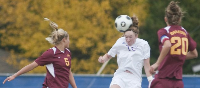 Kansas University defender Shelby Williamson, center, heads a ball out of midfield between Iowa State's Jordan Bishop (5) and Lauren Fader. KU beat the Cyclones, 1-0, Sunday at the Jayhawk Soccer Complex.