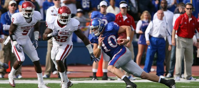Kansas receiver Kerry Meier heads up field as he is met by Oklahoma defenders Joseph Ibiloye (5) and Keenan Clayton (22) during the first quarter at Kivisto Field, Friday, Oct. 24, 2009.