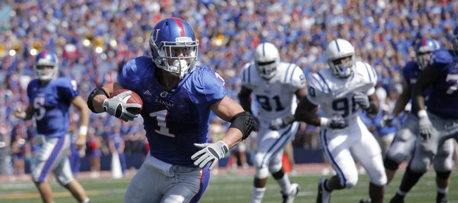 Kansas running back Jake Sharp seeks the end zone after making a catch in a September 2009 game against Duke.