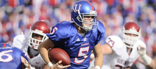 Kansas university quarterback Todd Reesing tries to escape from pressure during the first half against Oklahoma on Saturday at Memorial Stadium. Reesing has struggled lately, but will try to regain some swagger on Saturday against Texas Tech in Lubbock, Texas.